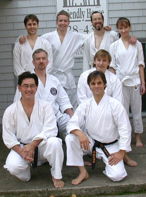 Portland SKA dojo members.  Taken outside The Friendly House November 10, 2001 immediately after the Kyu test.  From left to right starting with the top row. Geof Clark, Chris Raymond, Don Buchholz, Marguerite Ignalsbe.  Middle row: Mervin Calverley, Fred Pool.  Front Row: Stuart Iwasaki, Brian Borrello.